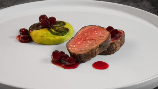 Venison loin with cranberry and fiddlehead