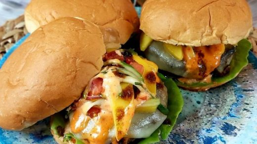 Jerk turkey burgers with coco bread buns and green mango salsa