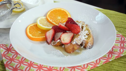 Lemon cheesecake French toast with orange liqueur strawberries