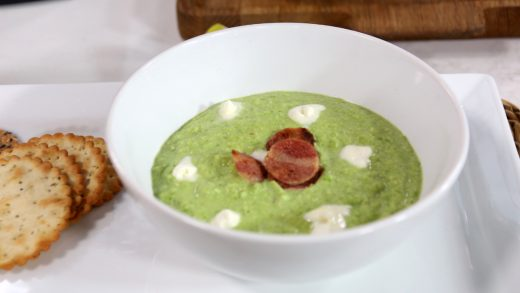 Pea soup with crème fraiche and crispy bacon chips