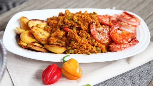 Jollof rice and peas with fried plantain