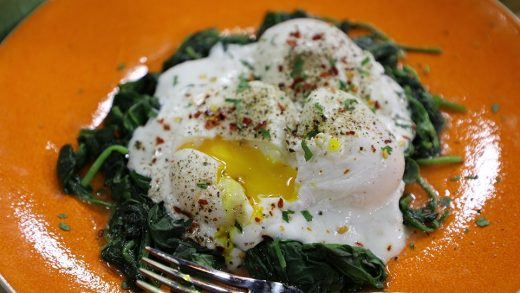 Poached eggs with wilted spinach and garlic yogurt