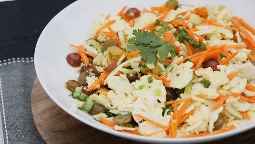 Cauliflower and carrot slaw with honey-curry vinaigrette