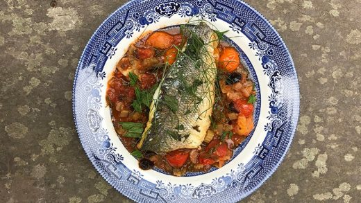Roasted sea bass with slow cooked tomato, olive and wild sorrel broth