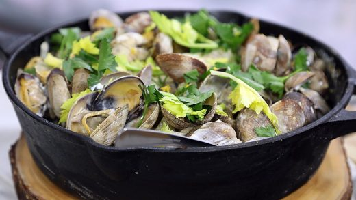Clams and cod in heavy cream with tiny potatoes and celery