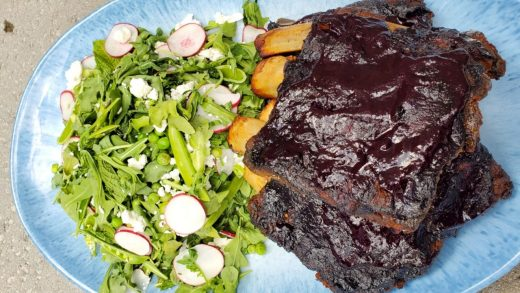 Bison ribs with wild blueberry BBQ sauce and arugula salad