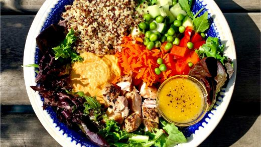 Chicken salad grain bowl with hummus and feta