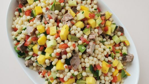 Jerk pork and pearl couscous salad with lime vinaigrette